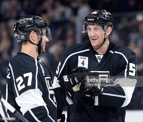 Alec Martinez of the Los Angeles Kings celebrates his goal with Jeff Schultz to take a 10 lead over the Anaheim Ducks during the second period at...