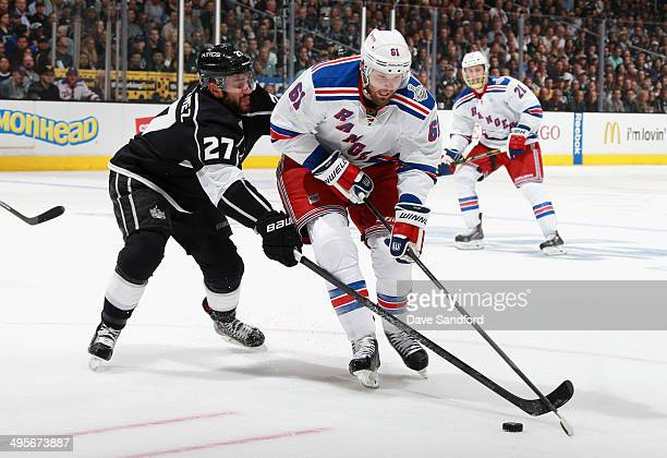 Alec Martinez of the Los Angeles Kings challenges Rick Nash of the New York Rangers during the second period of Game One of the 2014 Stanley Cup...
