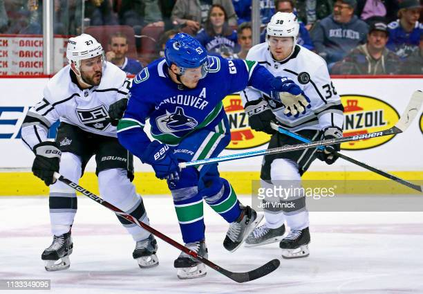 Alec Martinez of the Los Angeles Kings checks Bo Horvat of the Vancouver Canucks during their NHL game at Rogers Arena March 28 2019 in Vancouver...
