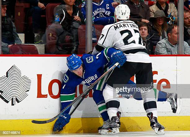 Alec Martinez of the Los Angeles Kings checks Linden Vey of the Vancouver Canucks during their NHL game at Rogers Arena December 28 2015 in Vancouver...