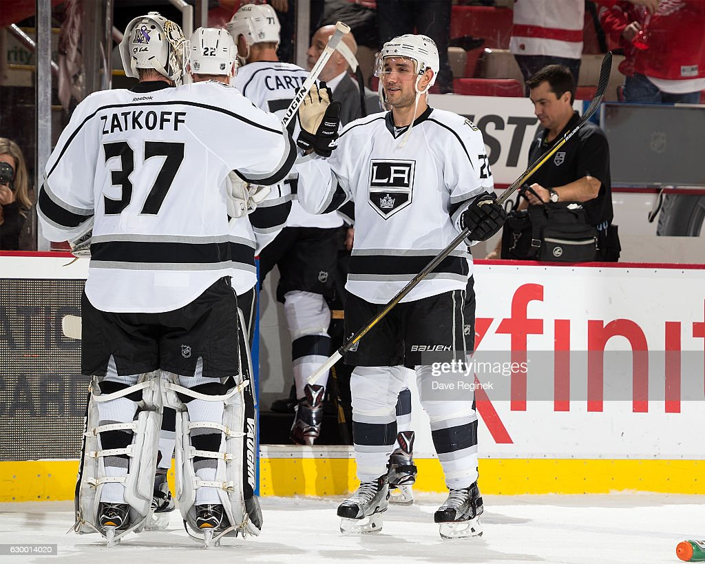 Alec Martinez #27 of the Los Angeles Kings high-fives teammate Jeff Zatkoff #37 on his win after an NHL game against the Detroit Red Wings at Joe Louis Arena on December 15, 2016 in Detroit, Michigan. The Kings defeated the Wings 4-1.