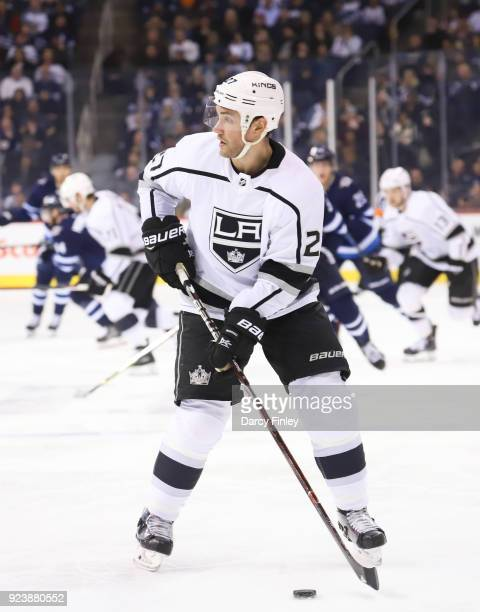 Alec Martinez of the Los Angeles Kings plays the puck down the ice during third period action against the Winnipeg Jets at the Bell MTS Place on...
