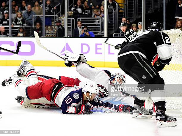 Alec Martinez of the Los Angeles Kings scores the game winning goal past a diving Sergei Bobrovsky and Alexander Wennberg of the Columbus Blue...