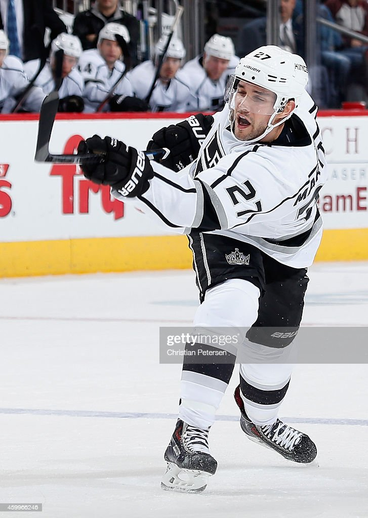 Alec Martinez #27 of the Los Angeles Kings shoots to score a third period goal against the Arizona Coyotes during the NHL game at Gila River Arena on December 4, 2014 in Glendale, Arizona. The Kings defeated the Coyotes 4-0.