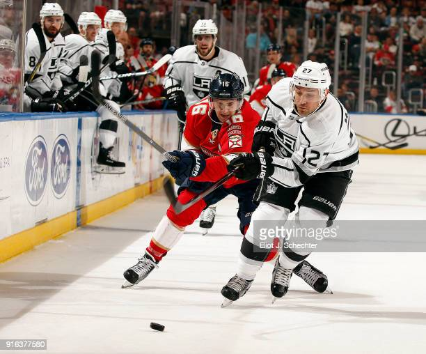 Alec Martinez of the Los Angeles Kings skates for possession against Aleksander Barkov of the Florida Panthers at the BBT Center on February 9 2018...
