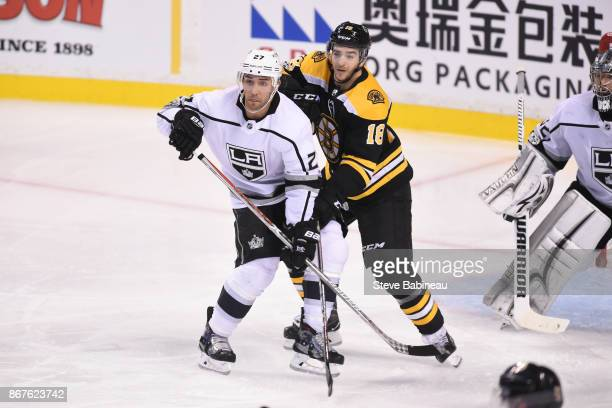 Alec Martinez of the Los Angeles Kings watches the play against Kenny Agostino of the Boston Bruins at the TD Garden on October 28 2017 in Boston...