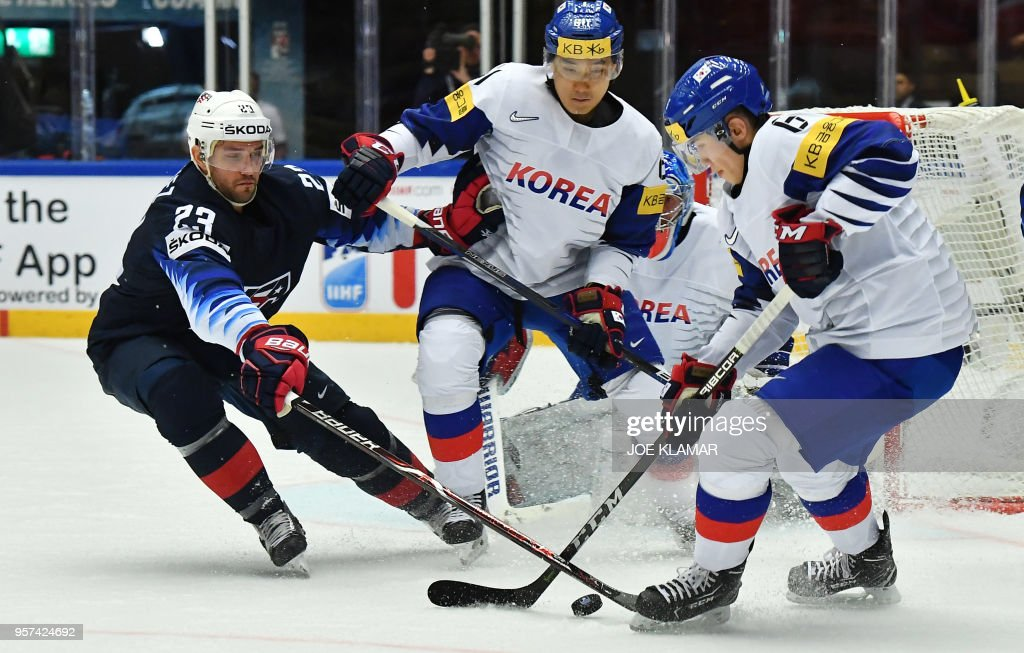 Alec Martinez of the United States (L) vies for the puck with South Korea's Kim Wonjun during the group B match the United States vs South Korea of the 2018 IIHF Ice Hockey World Championship at the Jyske Bank Boxen in Herning, Denmark, on May 11, 2018.