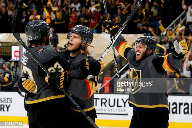 Alec Martinez of the Vegas Golden Knights is congratulated by William Karlsson and Jonathan Marchessault after scoring a goal against the Montreal...