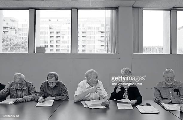 Alec McRae Lee Giesecke Dean Blehert Pam Blehert and Ron Vardiman discuss a poem during a meeting of the Federal Workers Poetry Project at the West...