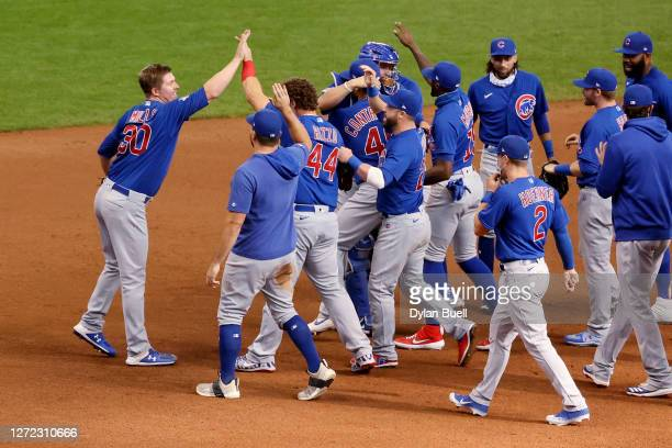 Alec Mills of the Chicago Cubs celebrates with teammates after throwing a no-hitter to beat the Milwaukee Brewers 12-0 at Miller Park on September...