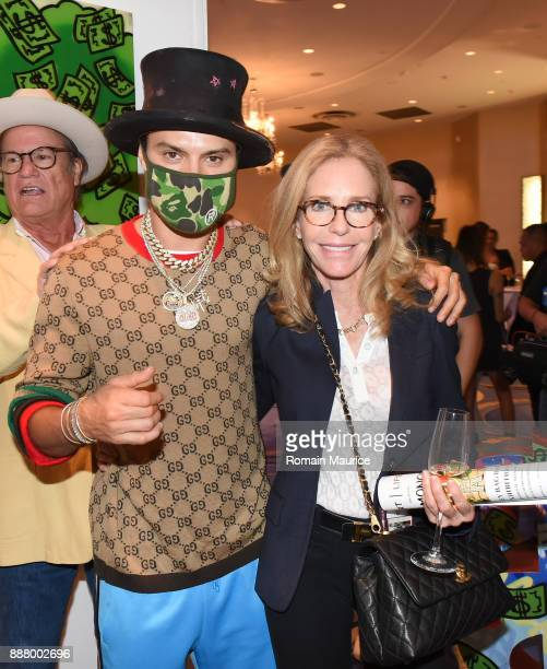 Alec Monopoly and Alexandra Andon attend Haute Living's VIP PopUp Opening Of Alec Monopoly From Art Life And David Yarrow From Maddox Gallery at...