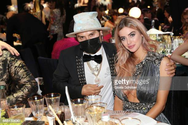Alec Monopoly and Eriica Jardim attend the amfAR Gala Cannes 2017 at Hotel du CapEdenRoc on May 25 2017 in Cap d'Antibes France