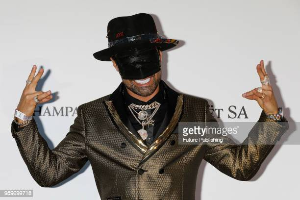 Alec Monopoly at the amfAR 25th Annual Cinema Against AIDS gala at the Hotel du CapEdenRoc in Cap d'Antibes France during the 71st Cannes Film...
