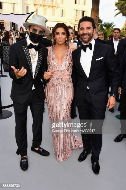 Alec Monopoly Eva Longoria and Jose Baston arrive at the amfAR Gala Cannes 2017 at Hotel du CapEdenRoc on May 25 2017 in Cap d'Antibes France