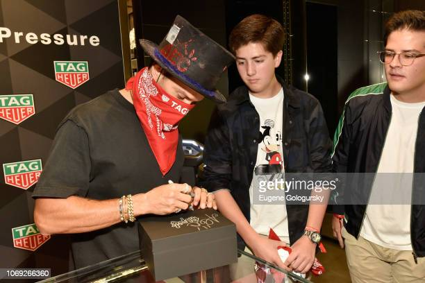 Alec Monopoly signs autographs at the TAG Heuer celebration of Art Basel Miami 2018 with the launch of Alec Monopoly's special edition timepieces on...