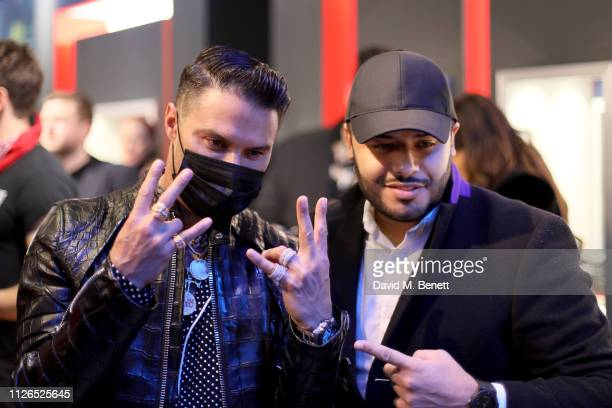 Alec Monopoly with fan at the TAG Heuer and art provocateur Alec Monopoly launch event celebrating special edition watches on January 31 2019 in...