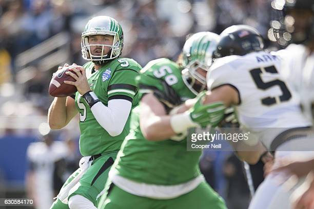 Alec Morris of the North Texas Mean Green drops back to pass against the Army Black Knights during the 1st half of the Zaxby's Heart of Dallas Bowl...