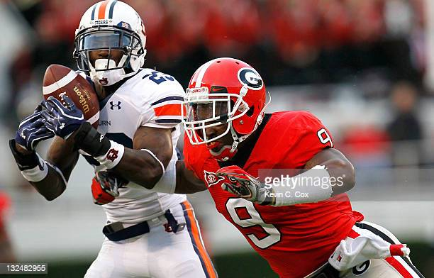 Alec Ogletree of the Georgia Bulldogs breaks a up a pass intended for Onterio McCalebb of the Auburn Tigers at Sanford Stadium on November 12 2011 in...