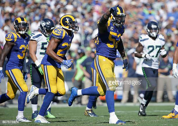 Alec Ogletree of the Los Angeles Rams celebrates during the fourth quarter of the home opening NFL game against the Seattle Seahawks at Los Angeles...