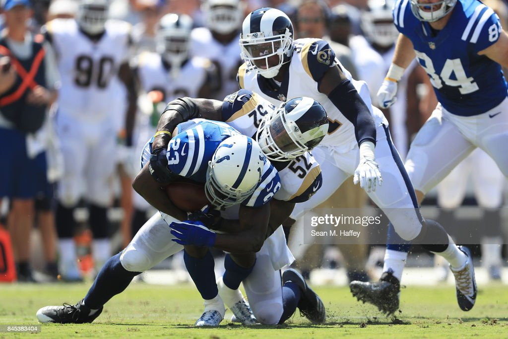 Alec Ogletree #52 of the Los Angeles Rams tackles Frank Gore #23 of the Indianapolis Colts at Los Angeles Memorial Coliseum on September 10, 2017 in Los Angeles, California.