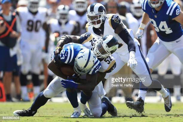 Alec Ogletree of the Los Angeles Rams tackles Frank Gore of the Indianapolis Colts at Los Angeles Memorial Coliseum on September 10 2017 in Los...