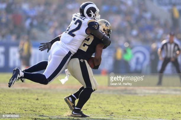 Alec Ogletree of the Los Angeles Rams tackles Mark Ingram of the New Orleans Saints during the first half of the game at the Los Angeles Memorial...
