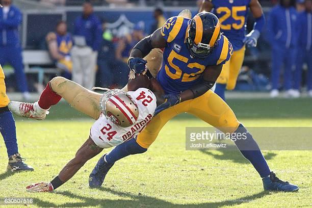 Alec Ogletree of the Los Angeles Rams tackles Shaun Draughn of the San Francisco 49ers during their game against the San Francisco 49ers at the Los...