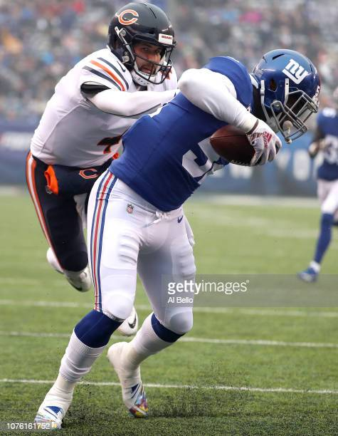 Alec Ogletree of the New York Giants escapes the tackle attempt of Chase Daniel of the Chicago Bears as he scores a firstquarter touchdown after...