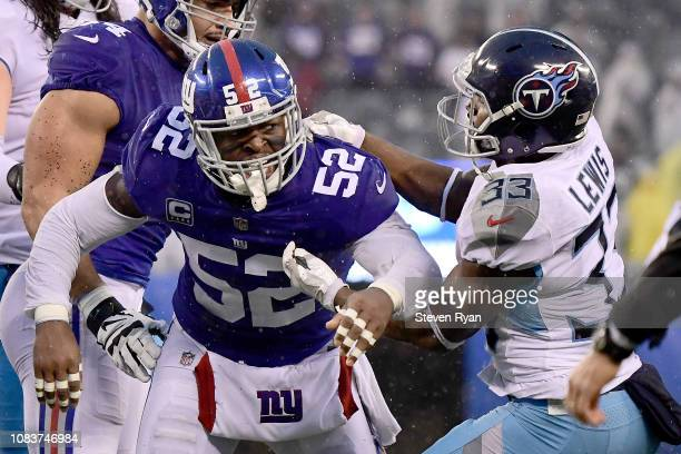 Alec Ogletree of the New York Giants gets into a fight with Dion Lewis of the Tennessee Titans at MetLife Stadium on December 16 2018 in East...