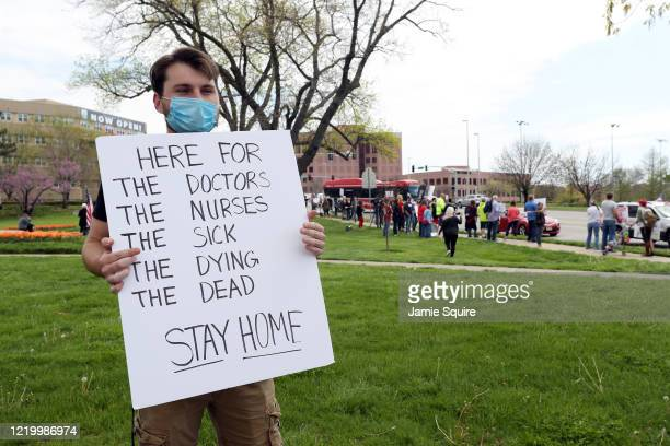 Alec Overmann, a supporter of the stay-at-home order, demonstrates at a protest against the order at the Country Club Plaza on April 20, 2020 in...
