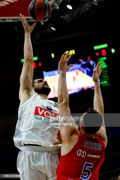 Alec Peters of CSKA Moscow vies with Filip Barovic of Buducnost during the Turkish Airlines Euroleague match between CSKA Moscow and Buducnost at the...