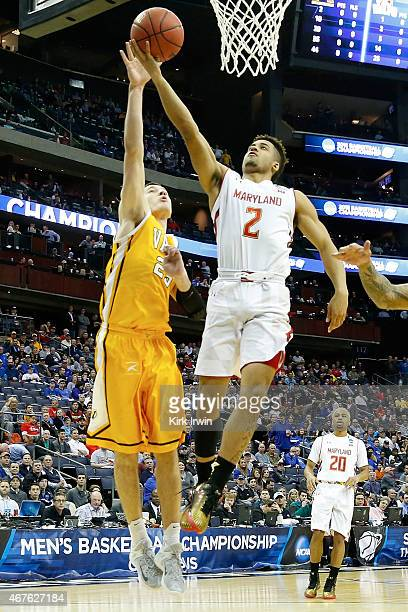 Alec Peters of the Valparaiso Crusaders attempts to block the shot of Melo Trimble of the Maryland Terrapins during the second round of the 2015 NCAA...