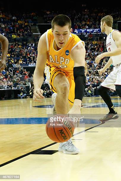 Alec Peters of the Valparaiso Crusaders reaches to control a loose ball during the second round of the 2015 NCAA Men's Basketball Tournament at...