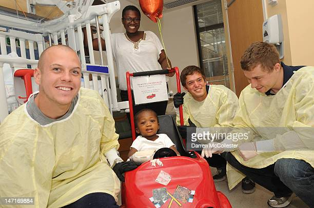 Alec Purdie Kelyn Rowe and Zak Boggs of the New England Revolution visit Adebayo and Mom at Boston Children's Hospital on June 26 2012 in Boston...