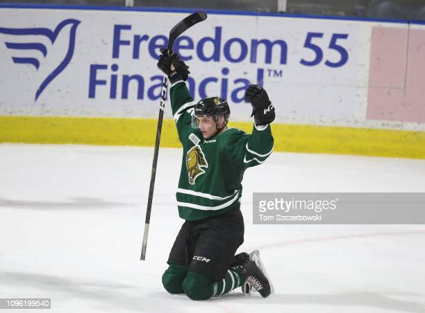 Alec Regula of the London Knights celebrates after scoring a goal in the third period during OHL game action against the Owen Sound Attack at...