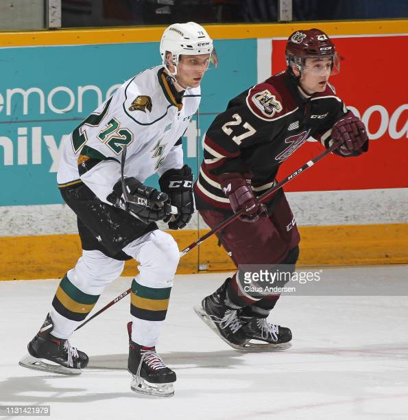 Alec Regula of the London Knights skates against Brady Hinz of the Peterborough Petes in an OHL game at the Peterborough Memorial Centre on February...