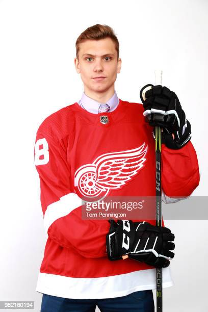 Alec Regula poses after being selected 67th overall by the Detroit Red Wings during the 2018 NHL Draft at American Airlines Center on June 23 2018 in...