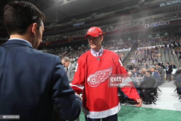 Alec Regula reacts after being selected 67th overall by the Detroit Red Wings during the 2018 NHL Draft at American Airlines Center on June 23 2018...