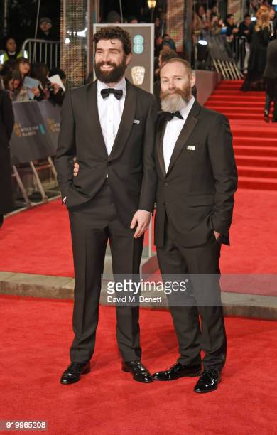 Alec Secareanu and Francis Lee attend the EE British Academy Film Awards held at Royal Albert Hall on February 18 2018 in London England
