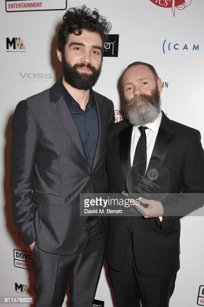 Alec Secareanu and Francis Lee winner of The Philip French Award for Breakthrough Filmmaker for 'God's Own Country' attend the London Film Critics'...