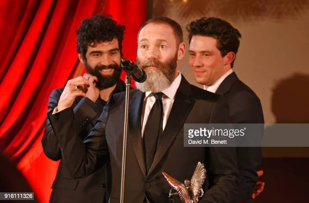 Alec Secareanu Francis Lee and Josh O'Connor accept the Everyman Award for Best Film for 'God's Own Country' at the London Evening Standard British...