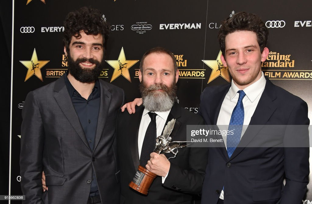 Alec Secareanu, Francis Lee and Josh O'Connor pose with the Breakthrough of the Year award for 'God's Own Country at the London Evening Standard British Film Awards 2018 at Claridge's Hotel on February 8, 2018 in London, England.
