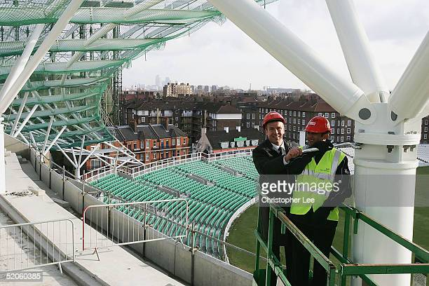 Alec Stewart and Mark Butcher of Surrey Cricket Club tigthen the final bolt during the Topping Out of the new Vauxhall End Stand for Surrey County...