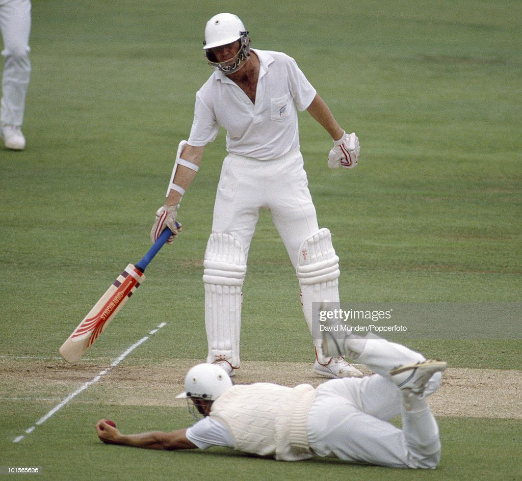 Alec Stewart fielding at short leg for England dives to catch New Zealand batsman John Wright who is out for 98 on the fourth day of the 2nd Test match between England and New Zealand at Lord's Cricket Ground in London, 21st June 1990. The match ended in a draw.