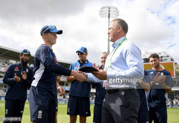 Alec Stewart hands over first cap to debutant Oliie Pope of England during Day Two of the Specsavers 2nd Test match between England and India at...