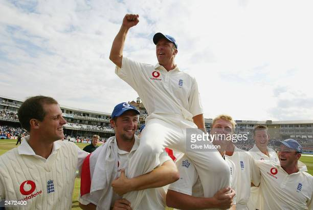 Alec Stewart of England celebrates on his teammates shoulders after England's victory over South Africa during the fifth day of the fifth npower test...