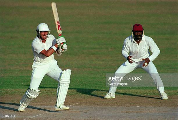 Alec Stewart of England hits out during the First Test Match between the West Indies and England held on February 24 1990 at Sabina Park in Kingston...