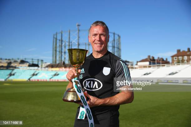 Alec Stewart of Surrey celebrates with the Specsavers County Championship Division One Cup during Day Four of the Specsavers County Championship...