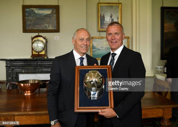 Alec Stewart receives a silver cap from ECB Chairman Colin Graves to commemorate reaching 100 test caps for England during the lucnch break on day...