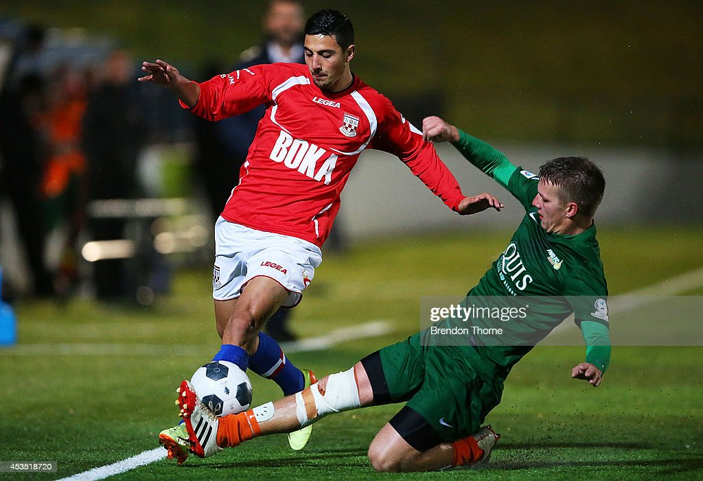 Alec Urosevski of United competes with Jake Keslake of the Heat during the FFA Cup match between Sydney United 58 FC and the FNQ Heat at Sydney United Sports Centre on August 12, 2014 in Sydney, Australia.
